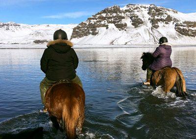 Horse riding over a lake